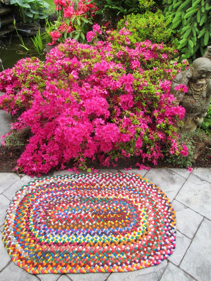 hand braided rug by Val Galvin, Renditions in Rags Hooked and Braided Rugs using recycled/reclaimed wool and wool fabric.
