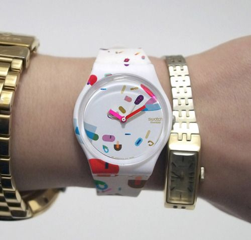 love multiple stacked wrist watches