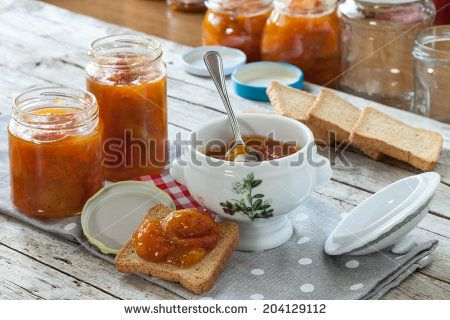 Fresh homemade apricots jam and rusks for breakfast. - stock photo