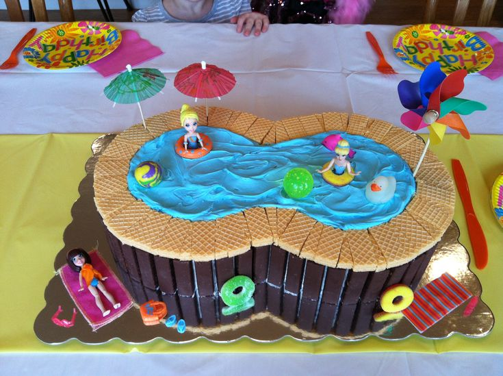 Swimming pool birthday cake. Use 9 inch round cake layer pans stacked two high. Decorate however you like. I found the accessories in my kids toy box.