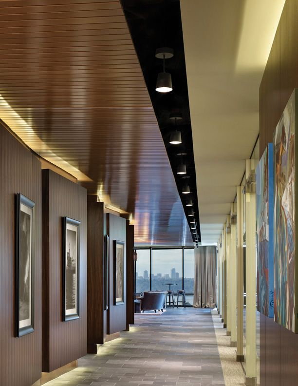 Toe kick lighting and up lighting along the hallway for for Office hallway design