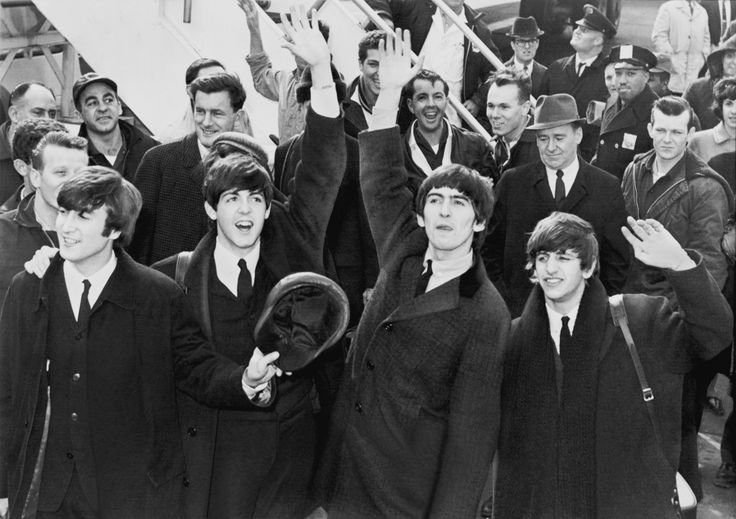 """The Beatles: The British band that provided a soundtrack to the American society and cultural evolution in the late 1960s. (Image: """"The Beatles arrive at John F. Kennedy International Airport, 7 February 1964"""" from the United States Library of Congress's Prints and Photographs division. Public domain via Wikimedia Commons.)"""