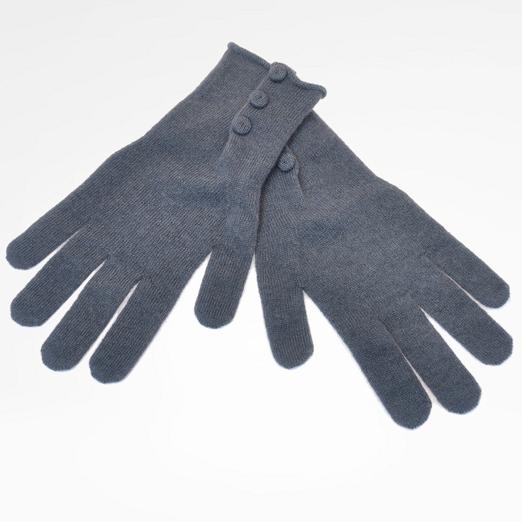 Gloves in soft pure cashmere. Classic design with a small crease where three little buttons (of the same color of the glove) are sewn. Soft and warm. Can be worn with other creations by the same designer.