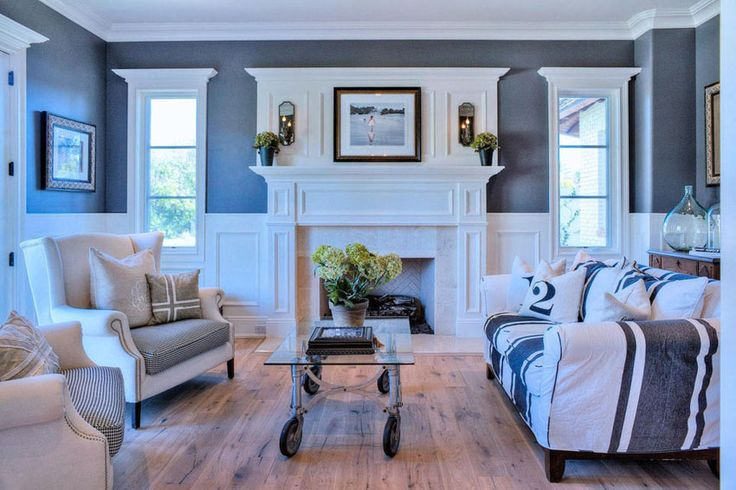 Transitional living room with wainscoting and weathered teak wood flooring