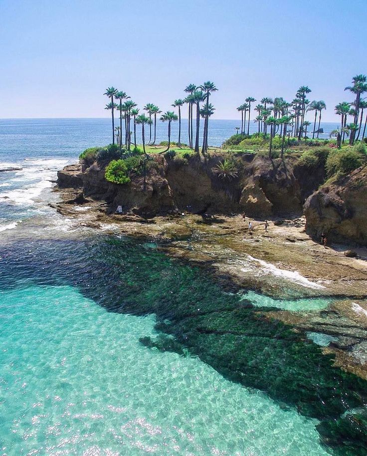 Laguna Beach, California. North of San Diego, South of LA. The blue/green water is what captivates me. I'm sure we can find more places further north, surely.