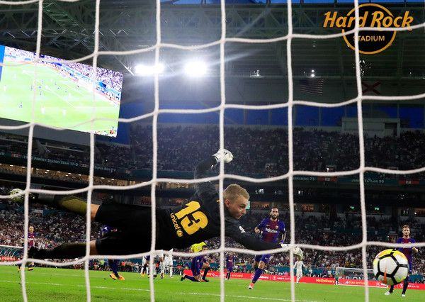 Jasper Cillessen #13 of Barcelona fails to stop a goal by Mateo Kovacic #16 of Real Madrid during their International Champions Cup 2017 match at Hard Rock Stadium on July 29, 2017 in Miami Gardens, Florida.