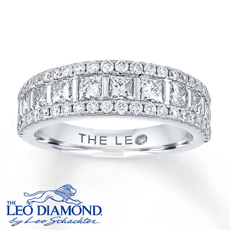 Elegantly appointed with a row of princess-cut Leo Diamonds in the center and round Leo Diamonds above and below, this beautiful anniversary band for her brilliantly celebrates the love of a lifetime. Crafted of 14K white gold, the ring has a total diamond weight of 1 3/4 carats. The diamonds are independently certified by Gemological Science International and GemEx. Diamond Total Carat Weight may range from 1.69 - 1.82 carats.