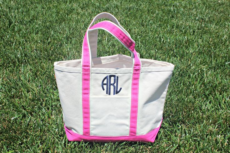 "The perfect and classic tote bag! Great for bridesmaids, running errands, or trip to the pool! Made of high quality canvas, zip closure, 1 outer pocket, 18"" handle. Shown with circle monogram, can do"