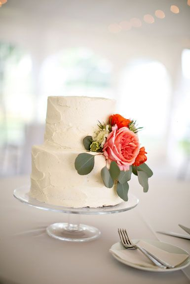 petite wedding cake with coral pink garden rose, orange and red ranunculus flower accents