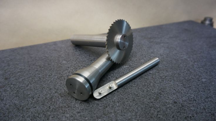 Two holders for slitting saws with locking tool
