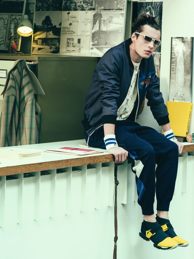 Adrien Sahores embraces luxurious blues in a Loewe bomber jacket, Levi's patterned shirt, Dior Homme argyle pants and Marni shoes.