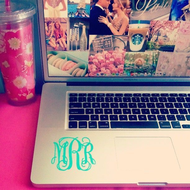 Monogrammed laptop...I really like how the back ground is a collage of pictures!!
