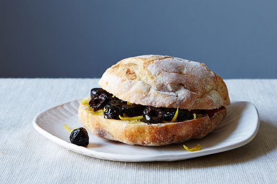 Viana La Place's Umbrian Black Olive Panino - Swipe a little garlic on your bread before you layer on tomatoes or cured meats. Or douse it in lemon and olive oil first (try this under a slab of fresh mozzarella). Consider zest. Fill a roll with marinated mushrooms, or roasted peppers, or pickles, and not much else. http://food52.com/recipes/31016-viana-la-place-s-umbrian-black-olive-panino