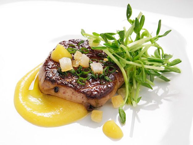 Seared foie gras with a creamy spiced orange puree and candied orange zest.