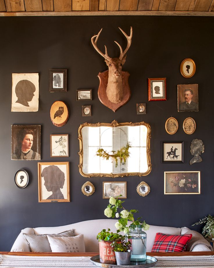 This cabin that mixes eras and textures is rustic, resilient and fits the family just right. Here, matte gray-black paint provides a sophisticated backdrop for a casual mix of framed and unframed family silhouettes, oil paintings, and a 1920s deer mount.
