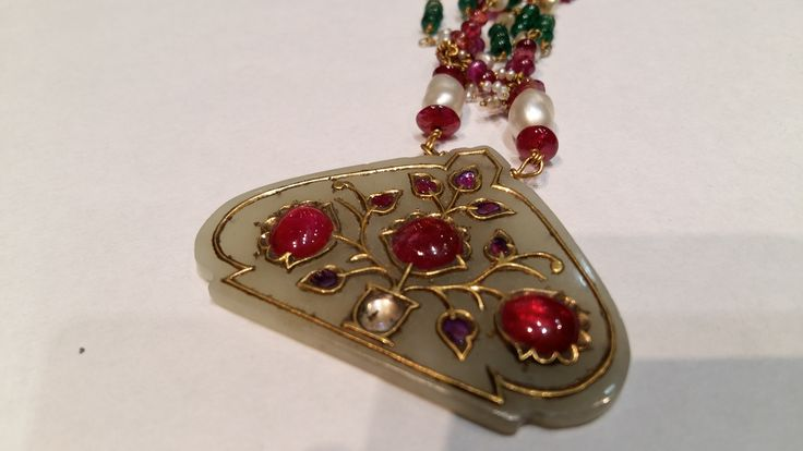 Necklace, North India. 19th Century, Nefrite jade pendant (HALDILI). The pendant is suspended on a necklace of alternating ruby and emerald beads and pearls.