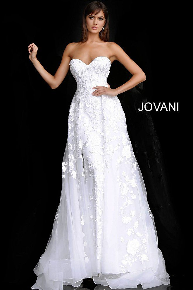 657f463cde159 ... bodice with sweetheart neck. Off white long fitted embellished wedding  dress with overskirt.