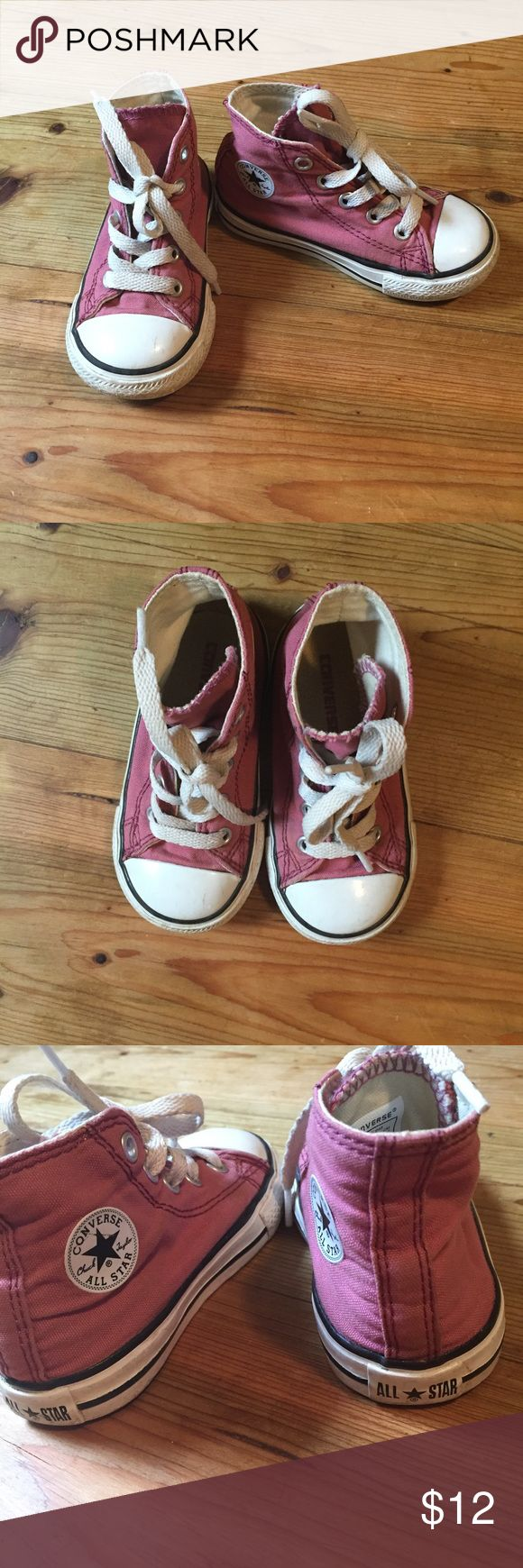 Converse pink high tops Converse All Stars high top sneakers, excellent condition, worn a handful of times. Super cute for your toddler! Converse Shoes Sneakers
