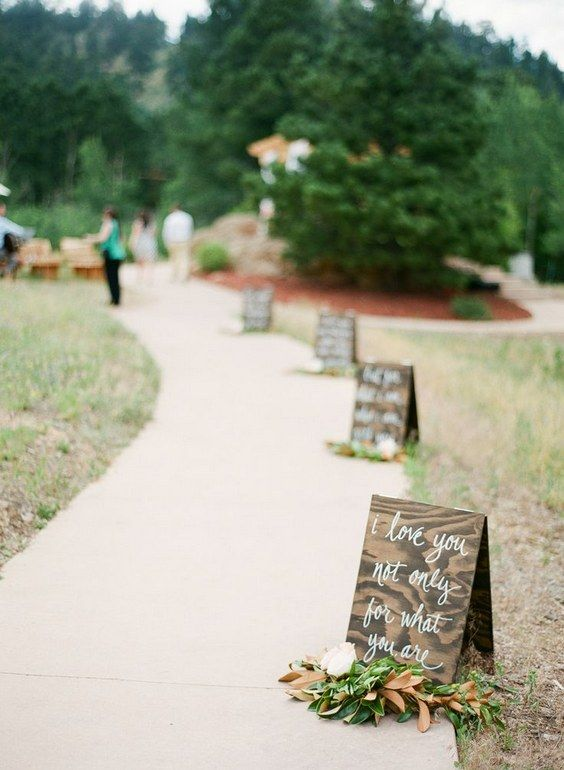 rustic wedding walkway with wedding sign decor / http://www.deerpearlflowers.com/wedding-entrance-walkway-decor-ideas/