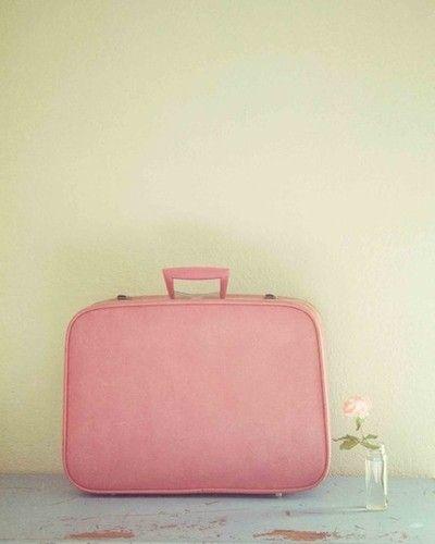 Vintage pink suitcase.