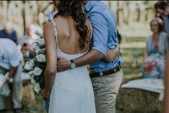 The happy bride and groom. Lezaan wore a bespoke Dimity bridal gown on her special day.