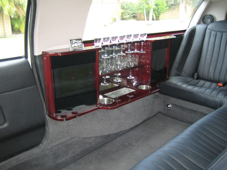 9 Seat Ford Fairlane Stretch Interior, Luxury Leather Seats, DVD Screens, Bar Facilities, Sound System with Sub Woofer,  #StretchLimosBrisbane #BrisbaneLimoHire #WeddingCarsBrisbane