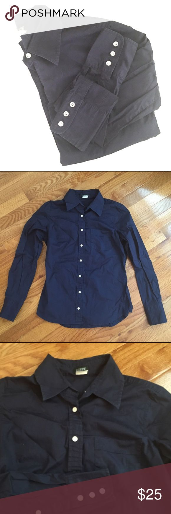 J. Crew Classic Stretch Button Down Sz XS This versatile piece is perfect for a casual dinner or a job interview. Navy blue with white buttons. Cotton and spandex blend. Pre-loved but in great condition. Please ask all questions! No trades. J. Crew Tops Button Down Shirts