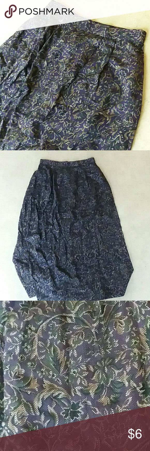 Jaclyn Smith petite long pleated skirt 5 Jaclyn Smith Petite size 5 long skirt. Is a dark purple with green and gold design. Has stretchy waist. In excellent condition Jaclyn Smith Skirts