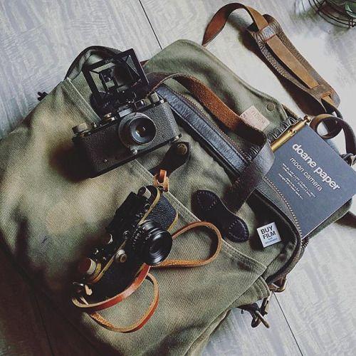 Eric Hessler packs a new moon camera idea journal into his well worn Filson bag.