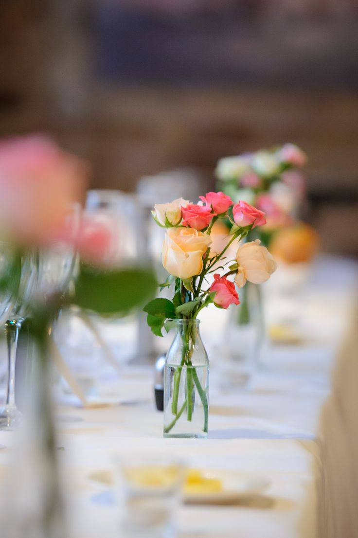 Wedding theme of soft, feminine, a bit traditional, with a slight pop of color. Beautiful colorful flower centerpiece.