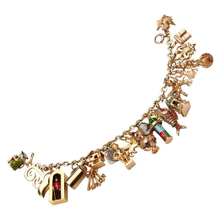 Who doesn't love Charm Bracelets? Not sure but I want this one! 1stdibs.com   Gold Charm Bracelet
