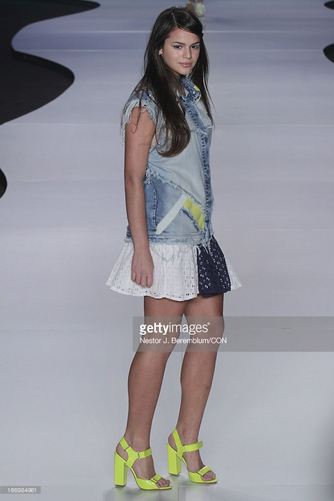Brazilian actress and girlfriend of football star Neymar, Bruna Marquezine, wears a design of Coca-Cola Clothing at Fashion Rio Spring/Summer 2013 on April 18, 2013 in Rio de Janeiro, Brazil.