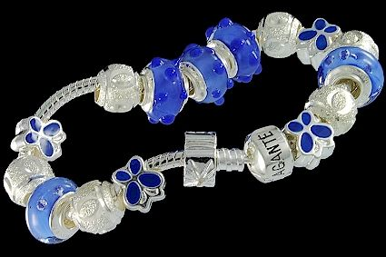 silver plated items: bracelet with snap closure, enamel beads, balls, lock. Five glass beads with 925 silver core and cubic zirconia.