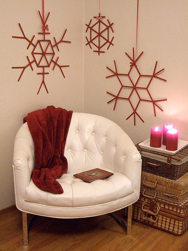 Giant red craft stick snowflakes