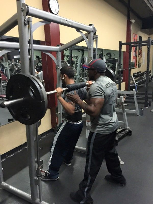There are awesome benifits from doing Smith Machine Squats. One major benifit, especially for people with knee issues is  that by standing with the feet forward, it takes pressure off the knees.  Another benifit comes for those who dont have access to a hack squat machine. Standing with the feet positioned forward makes for an excellent hack squat alternative.