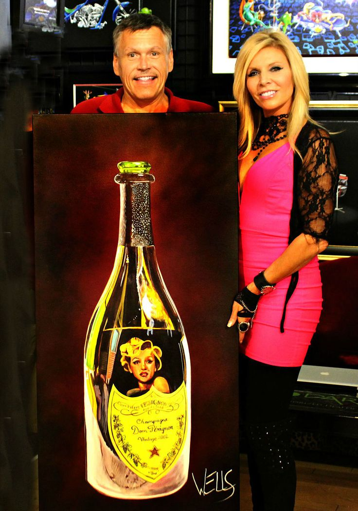 """Proud art collector with his new Wells original """"Gentlemen Prefer Dom"""" a champagne bottle reflecting Marilyn Monroe capturing time in a bottle. this art hangs in its new home alongside a Peter Max artwork. #staceywells #wine #champagne. #Petermax #marilynmonroe"""
