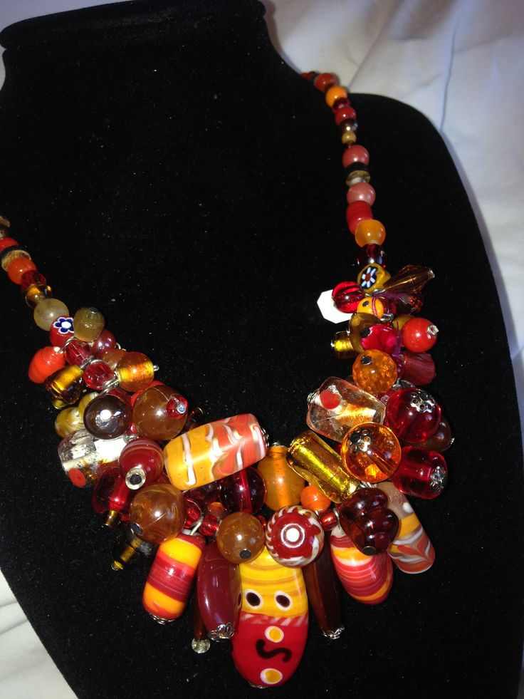 stones collar crystals, orange, red, adding several different colors all making a color matching