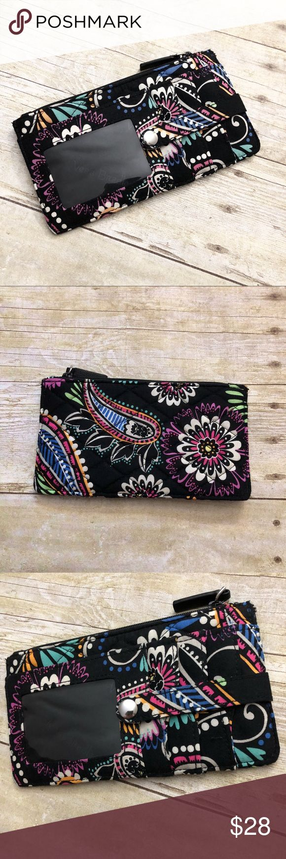 "Vera Bradley Skinny Wallet in Bandana Swirl. NWOT Never used. New without tags. Vera Bradley. Black paisley print. Skinny wallet. 1 long slip pocket, 1 long zip-close pocket, an ID holder and 3 card slots with button closure. Measurements shown in last photos.  ❌ No trades or off Poshmark transactions.   👌🏻Quick shipping.   💁🏻Offers welcome through ""Make an Offer"" feature.   👗👠 Bundle discount.   ❔ Feel free to ask any questions. Vera Bradley Bags Wallets"