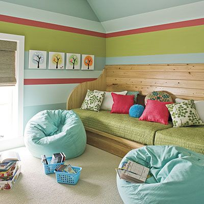 Two twin mattresses, some plywood, and a great playroom that doubles as a guest room or sleepover room. Love it! I like the striped walls too awesome