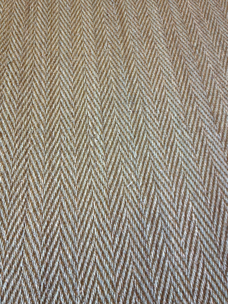 An updated seagrass featuring a traditional herringbone design. We offer ours for installation that features an attached urethane cushion for better comfort and durability. Available at Hemphill's Rugs & Carpets Orange County, California. Need an area rug? We offer that too with a huge selection of binding options.