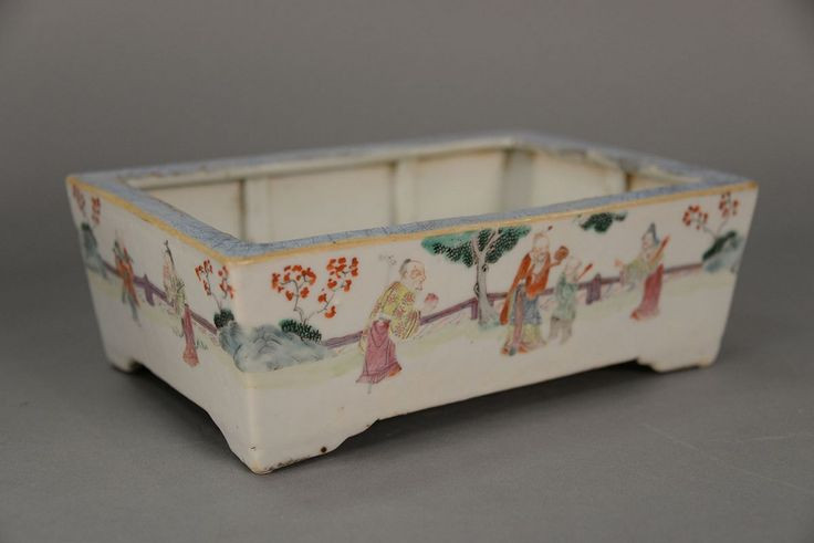 Famille Rose rectangular planter with enameled scholars and Guanyins.