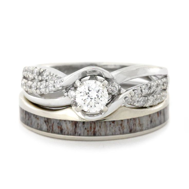 We see it all the time; the girly-girl falls for the outdoorsy huntsman. Here's a bridal set that pleases her glam side but at the same time, goes with his deer antler wedding band. A match made in heaven!