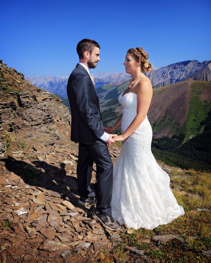 """Bride and groom saying """"I do"""" on the top of a mountain in Canmore, Alberta. Summer heli-wedding. Canmore Alberta wedding."""