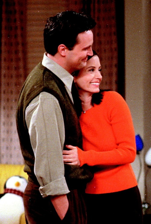 Chandler and Monica. I know this is irrelevant, but I love that Hugsy is in the background :)
