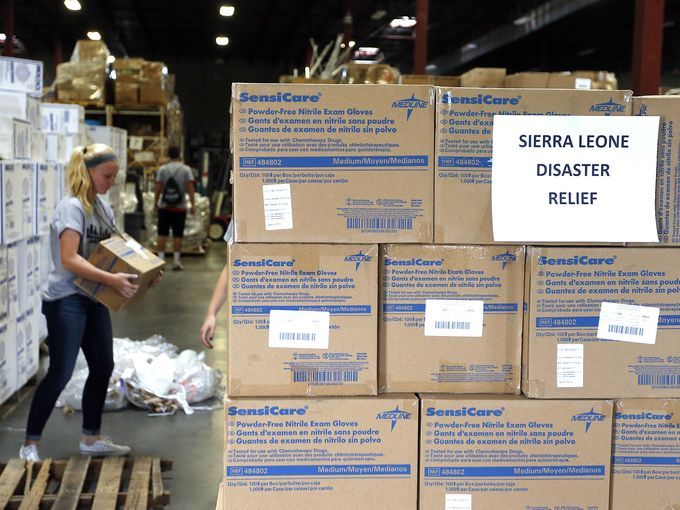 Paige Kula, a Valor Christian High School sophomore and volunteer, loads a pallet with medical supplies bound for Sierra Leone at the Project CURE warehouse in Centennial, Colo. The charity is shipping $400,000 of supplies to West Africa to help stop the spread of the Ebola virus.