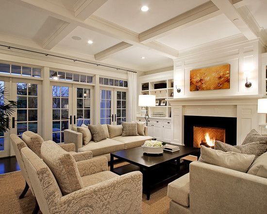 Oh my! This is my dream living room. No doubt. Perfect blend of contemporary and traditional craftsman style. The ceilings, the doors/windows, the built-ins around the fire place, wow.