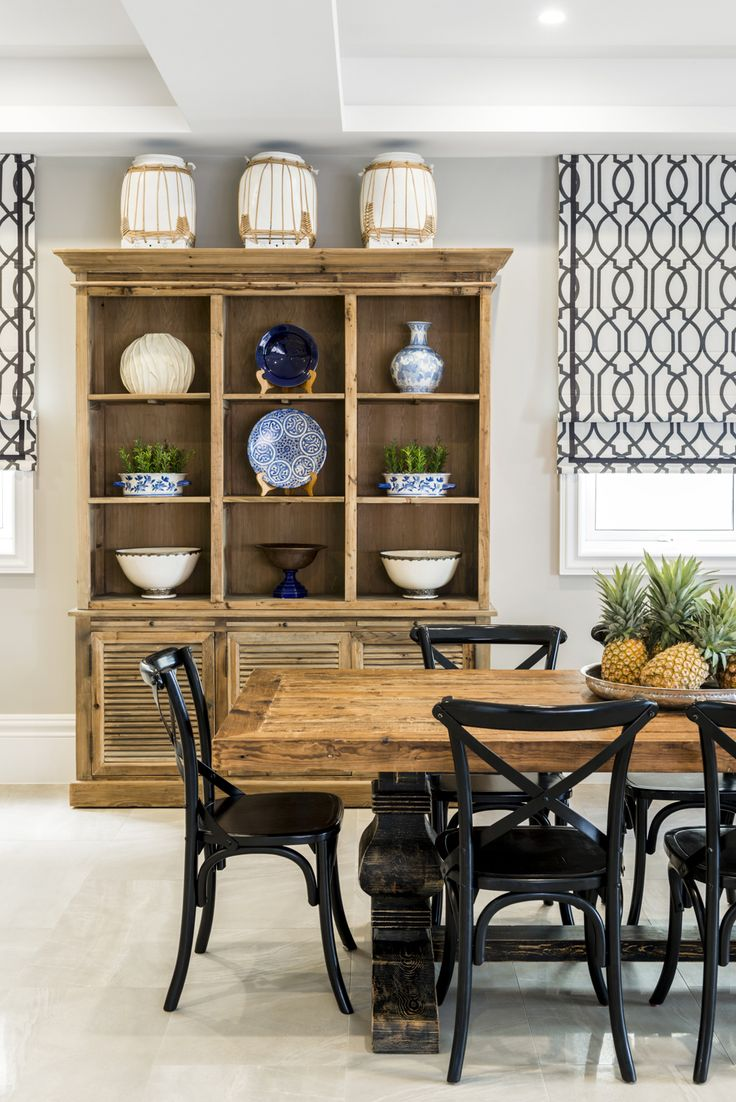 Dining Room Featuring A Rustic Teak Table With Black Chairs Roman Blinds In