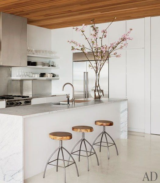 White lacquered cabinets. Wood ceilings.