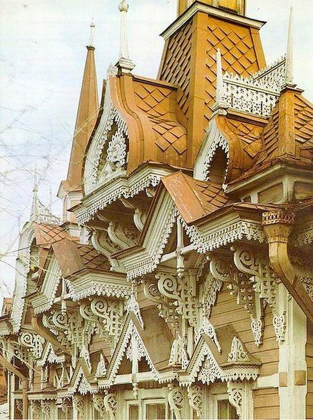 Russian wooden house decorated with openwork carving.
