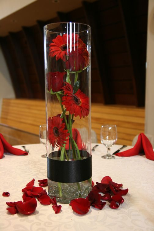 i love this as my center pieces. I'll have brown, burgandy, and yellow gerbers